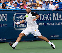 Marcos Baghdatis returns a serve during the Legg Mason Tennis Classic at the William H.G. FitzGerald Tennis Center in Washington, DC.  David Nalbandian defeated Marcos Baghdatis in straight sets in the finals Sunday afternoon.