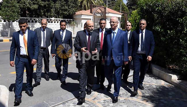 Palestinian Prime Minister Rami al-Hamdallah meets with Jordan Prime Minister Omar al-Razzaz, in Amman, Jordan on September 17, 2018. Photo by Prime Minister Office