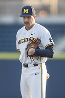 Michigan Wolverines pitcher Jack Bredeson (34) looks to his catcher for the sign against the Western Michigan Broncos on March 18, 2019 in the NCAA baseball game at Ray Fisher Stadium in Ann Arbor, Michigan. Michigan defeated Western Michigan 12-5. (Andrew Woolley/Four Seam Images)