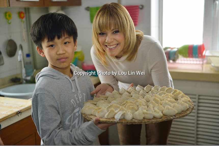 "Swiss singer and TV presenter Francine Jordi and Wang Tianshuo prepares for lunch while visiting ""SOS Kinderdorf"" in Tianjin, China.  22-Mar-2016"