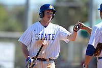 South Dakota State JackRabbits infielder Matt Johnson (9) after scoring a run during a game against the Georgetown Hoyas at South County Regional Park on March 9, 2014 in Port Charlotte, Florida.  Georgetown defeated South Dakota 7-4.  (Mike Janes/Four Seam Images)