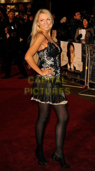 "ZOE SALMON.Attending the UK Film Premiere of ""Seven Pounds"" at the Empire Cinema, Leicester Square, London, England, January 14th 2009..full length black corset dress lace-up back rear over shoulder behind red soles shoes heels tights lace sheer layered hand on hip Christian Louboutins.CAP/CAN.©Can Nguyen/Capital Pictures"