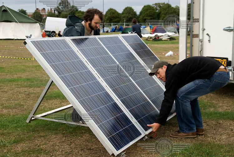 Solar panels are erected on the first day of the Climate Camp at Blackheath, London, the latest in a series of protests organised by Camp for Climate Action calling for a carbon-neutral society.