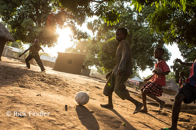 SOUTH SUDAN, Yambio: 16 March 2019 <br /> World Vision South Sudan - Children Associated with Armed Forces and Groups.<br /> Children of the community play football in their village in Yambio. World Vision visits many different communities across South Sudan, offering a wide variety of help and support to locals.