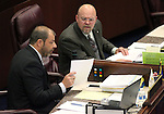 Nevada Assembly Republicans Paul Anderson, left, and Ira Hansen work on the Assembly floor at the Legislative Building in Carson City, Nev., on Friday, May 22, 2015. <br /> Photo by Cathleen Allison