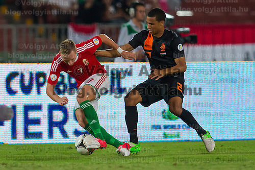 Hungary's Balazs Dzsudzsak (L) and Netherlands' Ricardo van Rhijn (R) fight for the ball during a World Cup 2014 qualifying soccer match Hungary playing against Netherlands in Budapest, Hungary on September 11, 2012. ATTILA VOLGYI