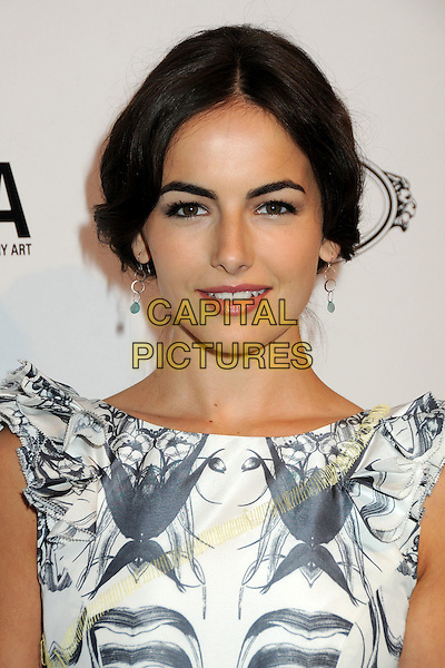 CAMILLA BELLE .TOD's Beverly Hills Boutique Launch Celebration held at TOD's Boutique, Beverly Hills, California, USA, .15th April 2010..portrait headshot hair up make-up earrings  sleeveless black and white print grey gray ruffle sleeve silver green stone dangly  mouth open .CAP/ADM/BP.©Byron Purvis/AdMedia/Capital Pictures.