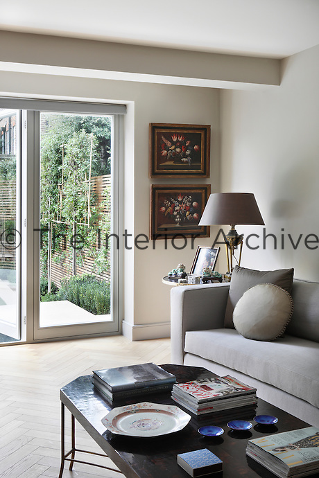 Fruit tree trellises can be seen supporting an abundance of greenery through the patio doors of this living area