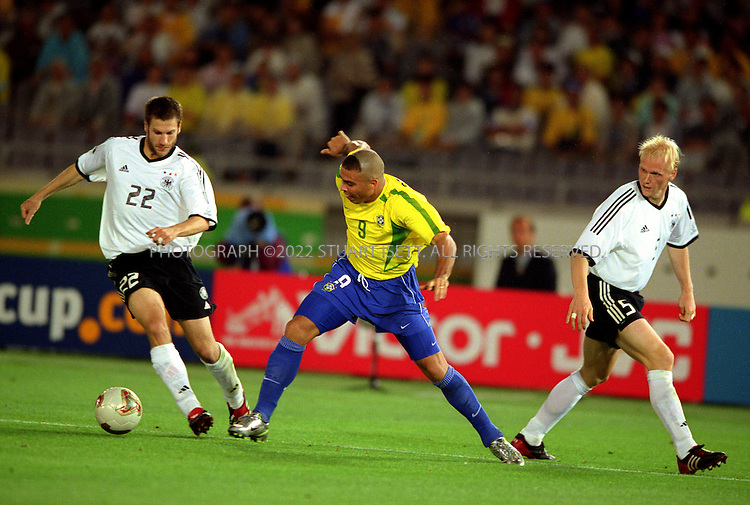 6/30/2002--Yokohama, Japan..Brazil's Ronaldo drives for the German goal in the opening minutes of the second half..Brazil beat Germany 2-0 to win the World Cup..All photographs ©2003 Stuart Isett.All rights reserved.This image may not be reproduced without expressed written permission from Stuart Isett.