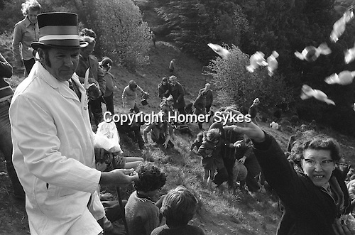 Cheese Rolling, Coopers Hill, Birdlip  Gloucestershire England 1975. Throwing out sweets at the starts of the custom.