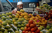 A muslim Indian man selling mangoes on a footpath in Kolkata, West Bengal,  India  7/18/2007.  Arindam Mukherjee/Landov