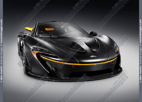 Matte black 2015 McLaren P1 plug-in hybrid supercar isolated sports car on gray background with clipping path