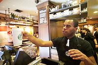 10/17/10 3:16:00 PM -- Seattle, WA, U.S.A - Starbucks barista Anton Coleman serves up a single brew cup coffee from the Clover Coffee Machine the newly remodeled Starbucks in Seattle. Starbucks is now offering wine, beer and dinner fare at their stores..