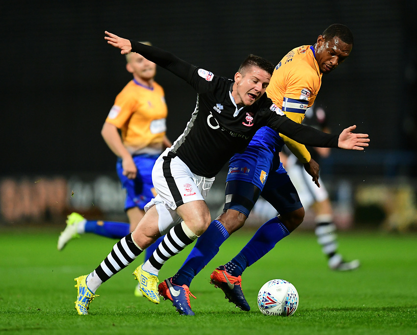 Lincoln City's Billy Knott is fouled by Mansfield Town's Krystian Pearce<br /> <br /> Photographer Chris Vaughan/CameraSport<br /> <br /> The EFL Checkatrade Trophy - Mansfield Town v Lincoln City - Tuesday 29th August 2017 - Field Mill - Mansfield<br />  <br /> World Copyright &copy; 2018 CameraSport. All rights reserved. 43 Linden Ave. Countesthorpe. Leicester. England. LE8 5PG - Tel: +44 (0) 116 277 4147 - admin@camerasport.com - www.camerasport.com