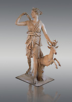 "Artemis and a deer, known as ""Diana of Versailles"", a 1st - 2nd century Roman statue in marble probably from Italy.  Artemis, Diana to the Romans, is goddess of the hunt, is accompanied by a deer.  The Diana of Versailles, similar to other Roman replicas was found in Libya or Turkey and was copied from a lost Greek bronze original attributed to Leochares, c. 325 BC .  First the statue was at Fontainbleau then the Louvre ancient hall and finally it went to Versailles. From the collection of Louis XIV, Pope Paul IV and Henry II (1556) . Inv MR 152 ( or Ma 589), Louvre Museum Paris"