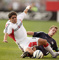 D.C. United's Jaime Moreno gets fouled by the New England Revolution's Rusty Pierce. The New England Revolution and D.C. United finished in a scoreless tie in MLS play at Gillette Stadium, Foxboro, MA on Saturday August 28, 2004.