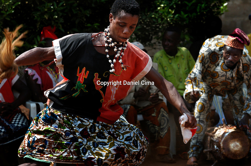 Benin dancers and musicians wearing .there typical clothing during a religious performance. Benin, Africa 2003