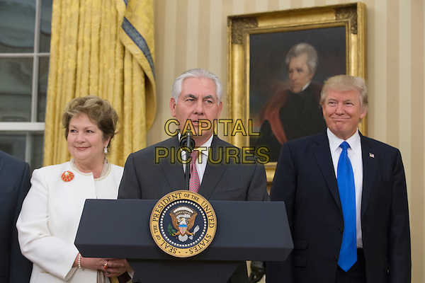 Rex Tillerson (C) delivers remarks after being sworn-in as Secretary of State, beside his wife Renda St. Clair (L), and US President Donald J. Trump (R) in the Oval Office of the White House in Washington, DC, USA, 01 February 2017. Tillerson was confirmed by the Senate, 01 February, in a 56-to-43 vote to become the nation's 69th Secretary of State.<br /> CAP/MPI/RS<br /> &copy;RS/MPI/Capital Pictures