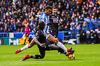 Crystal Palace's defender Mamadou Sakho (12) tackles Huddersfield Town's forward Steve Mounie (24) during the EPL - Premier League match between Huddersfield Town and Crystal Palace at the John Smith's Stadium, Huddersfield, England on 17 March 2018. Photo by Stephen Buckley / PRiME Media Images.