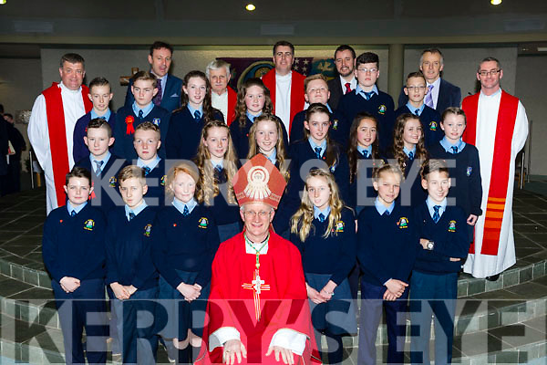 Mr Noel O'Sullivan class from St Olivers NS pupils with Bishop Ray Browne Fr Kieran O'Brien, Fr Niall Howard, Fr Paddy O'Donoghue, Fr Niall Geaney and Fr Jim Linehan, Rory Darcy Principal and teacher Mr Horgan at their Confirmation in Church of the Ressurection on Friday