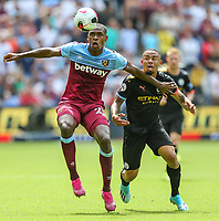 Issa Diop of West Ham United and Gabriel Jesus of Manchester City during the Premier League match between West Ham United and Manchester City at the London Stadium, London, England on 10 August 2019. Photo by David Horn.