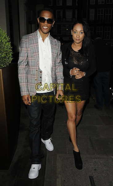 Romeo Dunn & Lisa Maffia.'The Cabin In The Woods' VIP screening, The May Fair Hotel, Stratton Street, London, England..5th April 2012.full length black grey gray white shirt check suit jacket sunglasses shades dress .CAP/CAN.©Can Nguyen/Capital Pictures.