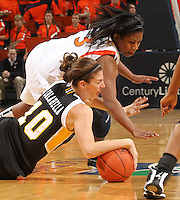 Dec. 18, 2010; Charlottesville, VA, USA; UMBC Retrievers 6-0 Meghan Colabella forward (10) goes after the loose ball with Virginia Cavaliers guard Paulisha Kellum (3) during the game at the John Paul Jones Arena.  Mandatory Credit: Andrew Shurtleff-