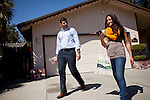 Republican congressional candidate Ricky Gill, left, and campaign volunteer Stephanie Freedman canvas voters in Stockton, Calif., September 18, 2012.