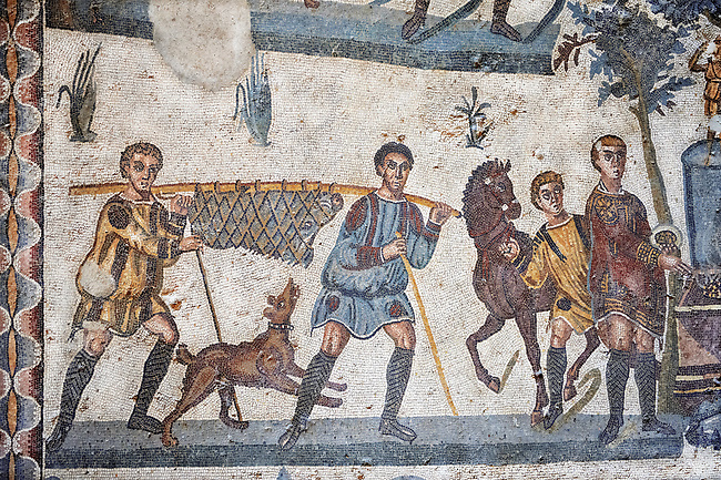 Hunters carrying a dead wild boar. Roman mosaic floor of the Room of The Small Hunt, no 25 - Roman mosaics at the Villa Romana del Casale ,  circa the first quarter of the 4th century AD. Sicily, Italy. A UNESCO World Heritage Site.