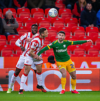 12th February 2020; Bet365 Stadium, Stoke, Staffordshire, England; English Championship Football, Stoke City versus Preston North End; Sean Maguire of Preston North End under pressure from James Chester od Stoke City - Strictly Editorial Use Only. No use with unauthorized audio, video, data, fixture lists, club/league logos or 'live' services. Online in-match use limited to 120 images, no video emulation. No use in betting, games or single club/league/player publications