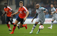 Cameron McGeehan of Luton Town and Ashley Chambers of Grimsby Town during the Sky Bet League 2 match between Luton Town and Grimsby Town at Kenilworth Road, Luton, England on 10 September 2016. Photo by Harry Hubbard / PRiME Media Images.