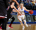 BROOKINGS, SD - MARCH 16:  Madison Guebert #11 from South Dakota State University drives against Mikayla Voigt	 #21 from Northern Illinois during their first round WNIT game Thursday at Frost Arena in Brookings.(Photo by Dave Eggen/Inertia)