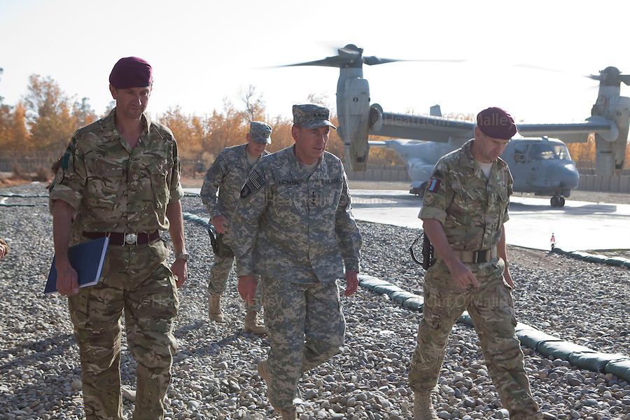 Mcc0027461 . Daily Telegraph..General David Petraeus  , Commanding General of ISAF ,flanked by (left) Lt Col James Coates and (right) Brigadier James Chiswell during his visit to FOB Shahzad where the 3 Para Battlegroup are based in the northern Nad e Ali district of Helmand Province...Helmand 29 November 2010