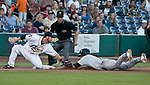 Reno Aces thrid baseman Taylor Harbin makes the tag for the out as Sacramento River Cats Grant Green slides into the bag during their game on Monday night July 30, 2012 at Aces Ballpark in Reno, Nevada.
