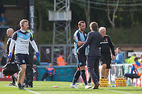 Paul Hayes of Wycombe Wanderers comes off after being treated by the medical staff during the Sky Bet League 2 match between Wycombe Wanderers and Hartlepool United at Adams Park, High Wycombe, England on 5 September 2015. Photo by Andy Rowland.