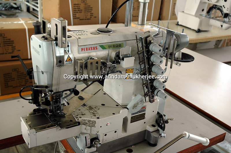 A Juki Singer machine (single needle lock stitch) at Popy's garment stitching factory in Tirupur, Tamilnadu. After lifting of quota system in textile export on 1st january 2005. Tirupur has become the biggest foreign currency earning town of India.