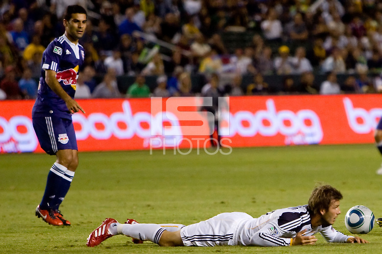 Midfielder of the LA Galaxy David Beckham lands on the ground as New York Red Bulls midfielder Rafael Marquez looks on. LA The New York Red Bulls beat the LA Galaxy 2-0 at Home Depot Center stadium in Carson, California on Friday September 24, 2010.