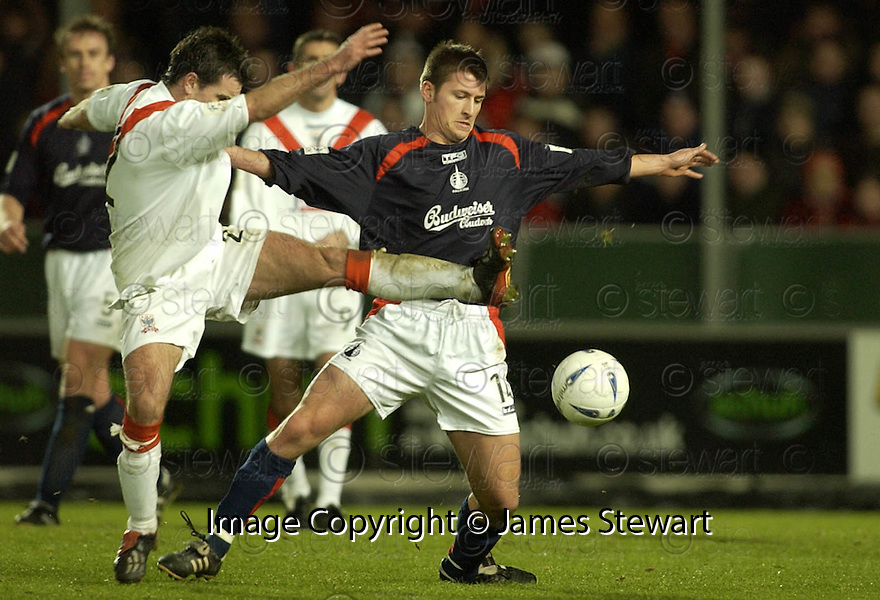 26/12/2004  Copyright Pic : James Stewart.File Name : jspa07_falkirk_v_airdrie.STEPHEN DOCHERTY AND NEIL SCALLY CHALLENGE FOR THE BALL....Payments to :.James Stewart Photo Agency 19 Carronlea Drive, Falkirk. FK2 8DN      Vat Reg No. 607 6932 25.Office     : +44 (0)1324 570906     .Mobile   : +44 (0)7721 416997.Fax         : +44 (0)1324 570906.E-mail  :  jim@jspa.co.uk.If you require further information then contact Jim Stewart on any of the numbers above.........