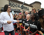 SIOUX FALLS, SD - JULY 20: KISS member Paul Stanley smiles as he interacts with kids at the Brennan Rock & Roll Academy Saturday afternoon in Sioux Falls.  (Photo by Dave Eggen/Inertia)