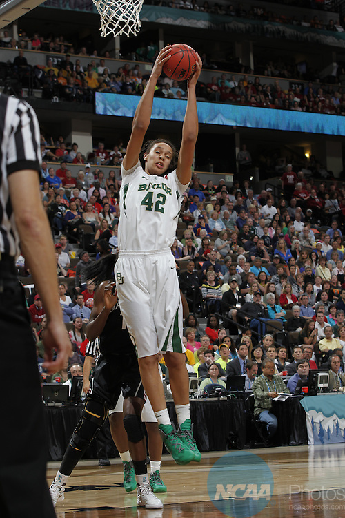 01 APRIL 2012:  Center Brittney Griner of Baylor University (42) grabs a rebound against Stanford University during the Division I Women's Final Four semifinals at the Pepsi Center in Denver, CO.  Baylor defeated Stanford 59-47 to advance to the championship final.  Jamie Schwaberow/NCAA Photos