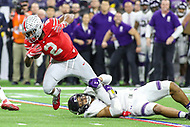 Indianapolis, IN - December 1, 2018: Ohio State Buckeyes defensive end Chase Young (2) gets tackled by Northwestern Wildcats defensive end Earnest Brown IV (98) during the Big Ten championship game between Northwestern  and Ohio State at Lucas Oil Stadium in Indianapolis, IN.   (Photo by Elliott Brown/Media Images International)
