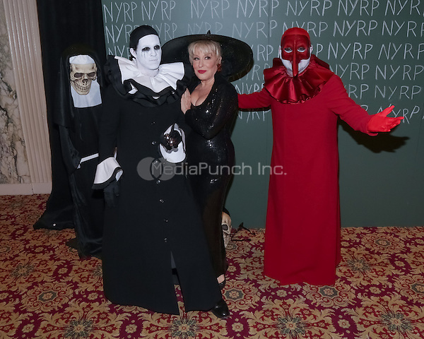 """NEW YORK, NY - OCTOBER 31 : Singer/Actress Bette Midler (center), Narcisco Rodriguez (R) and Guest arrive for the New York Restoration Project's 19th Annual Hulaween Gala """"FELLINI HULAWEENI"""" held at the Waldorf Astoria on October 31, 2014 in New York City.  (Photo by Brent N. Clarke / MediaPunch)"""