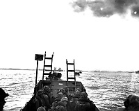 Carrying scaling ladders, U.S. Marines in landing crafts head for the seawall at Inchon.  September 15, 1950.  S.Sgt. W. W. Frank.  (Marine Corps)<br /> NARA FILE #:  127-N-A3189<br /> WAR & CONFLICT BOOK #:  1418