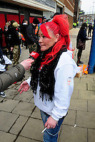 English Defence League (EDL) demonstration<br /> Called in protest to the proposed building of a new mosque in Dudley.<br /> A woman supporter of the English Defence League being interviewed by Heart FM radio station.