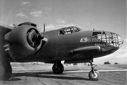 """When the United States entered World War 2,  the A-20 attack bomber had already been proven in combat by British and French forces. On July 4, 1942, six A-20s flown by American crews of the 15th Bombardment Squadron accompanied six flown by British crews on a low-altitude mission against four Dutch airfields, the first United States daylight bombing raid in Europe.  The versatile A-20 was used in the Pacific, Middle East, North African, Russian, and European theaters. Some A-20s equipped with radar equipment and additional nose guns were redesignated as P-70s and were used as night fighters until replaced in 1944 by the P-61 """"Black Widow"""" with its increased high altitude performance.  A-20 production halted in September 1944 with more than 7,000 built for the U.S. and its allies. .Credit: U.S. Air Force via CNP"""