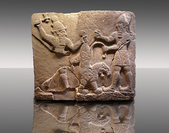 Picture & Image of  Neo-Hittite orthostat describing the legend of Gilgamesh from Karkamis,, Turkey. Museum of Anatolian Civilisations, Ankara. To the left a bearded deity with a horned helmet is holding a lions back leg and is about to strike it with an axe. To the right a man is stabbing the lion with a dagger. 3
