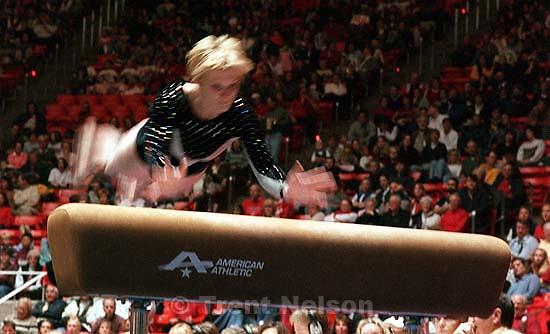 Denise Jones on the vault at Utah vs. Utah State gymnastics.<br />
