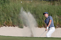 Russell Henley (USA) hits out of a sand trap on the 18th hole during the first round of the 118th U.S. Open Championship at Shinnecock Hills Golf Club in Southampton, NY, USA. 14th June 2018.<br /> Picture: Golffile | Brian Spurlock<br /> <br /> <br /> All photo usage must carry mandatory copyright credit (&copy; Golffile | Brian Spurlock)