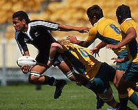 Eddie Quirk tackles Joseph Tupe as he looks for support during the International rugby match between New Zealand Secondary Schools and Suncorp Australia Secondary Schools at Yarrows Stadium, New Plymouth, New Zealand on Friday, 10 October 2008. Photo: Dave Lintott / lintottphoto.co.nz