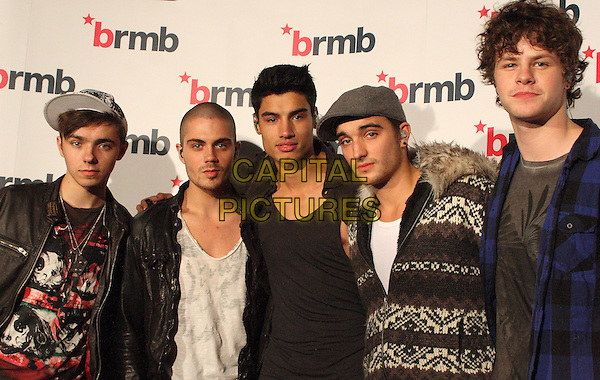 THE WANTED - Nathan Sykes, Max George, Siva Kaneswaran, Tom Parker & Jay McGuiness .BRMB Live 2010 at the LG Arena, Birmingham, England..November 27th 2010.half length band group brown black blue grey gray white check knitted jumper sweater hat.CAP/JIL.©Jill Mayhew/Capital Pictures